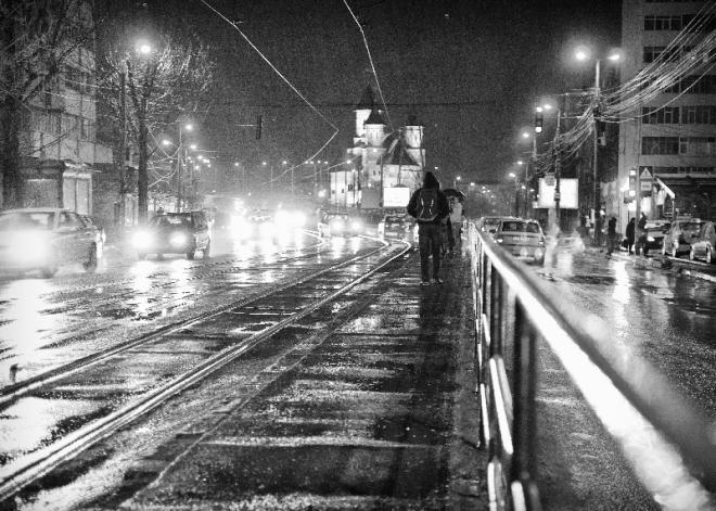 tram station under hevvy rain.