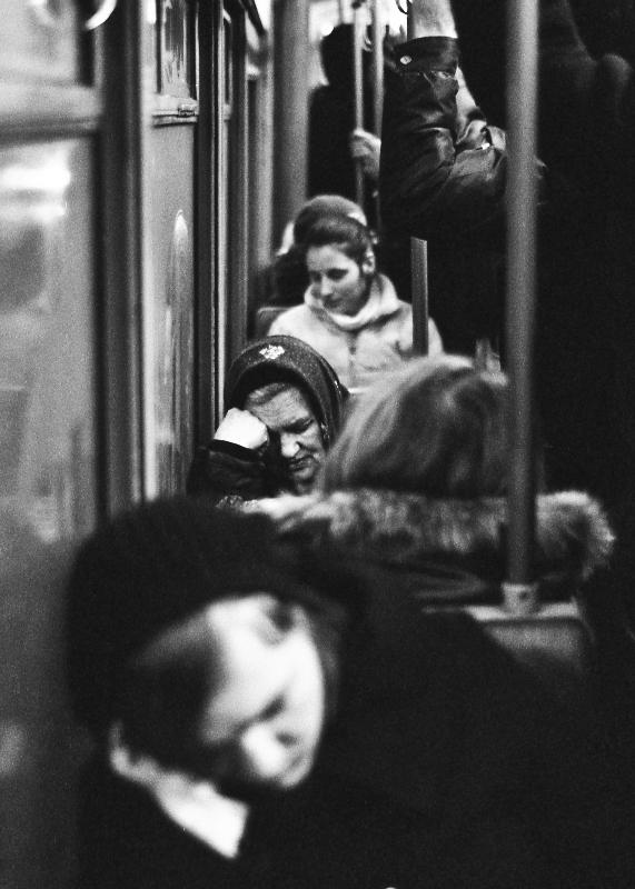 women sleaping in public transport