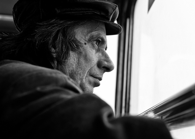 man looking out of tram window