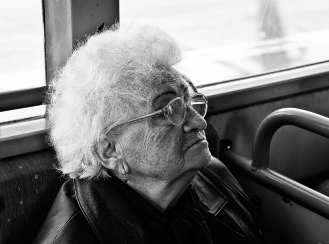 old woman staring in public transport