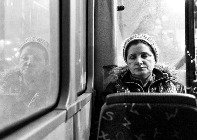 reflexion of a woman in public transport